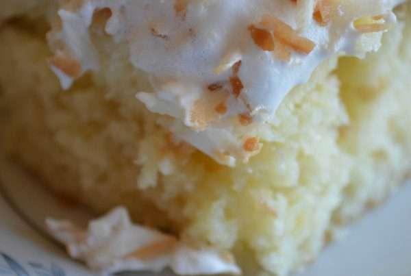 TOASTED COCONUT POKE CAKE