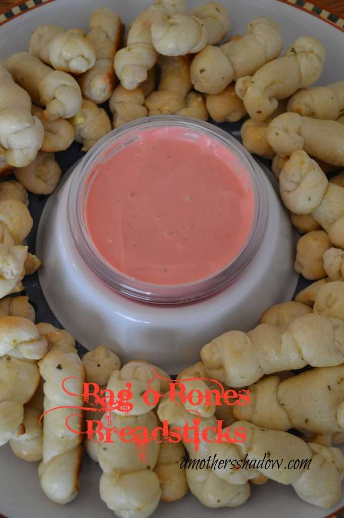 refrigerator dough shaped like bones and served with a dipping sauce colored red