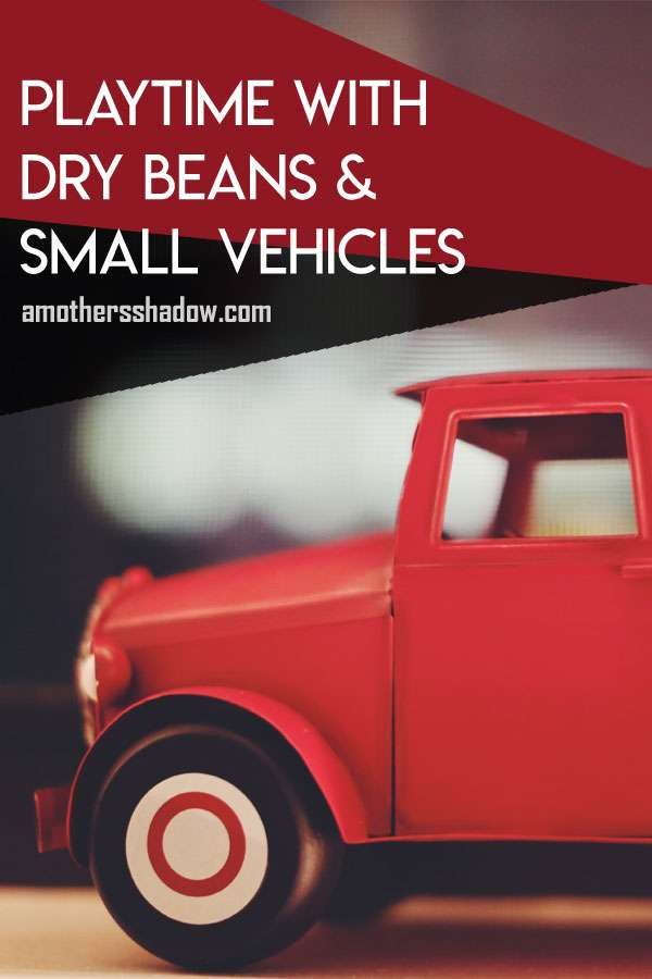 Dry Beans and small toy vehicles or construction toys for kids to play with instead of sand for use indoors