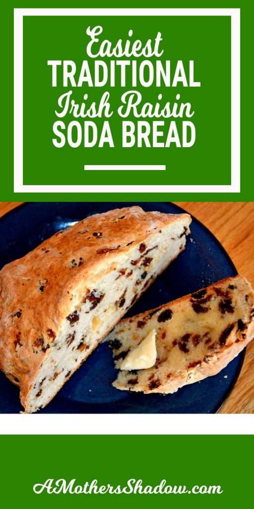 A delicious round loaf of the best traditional Irish Soda Bread with raisins is sitting on a plate. A couple of slices are sitting on the side of the plate with melted butter on them. The bread is moist, great flavor and makes scrumptious toast the next day